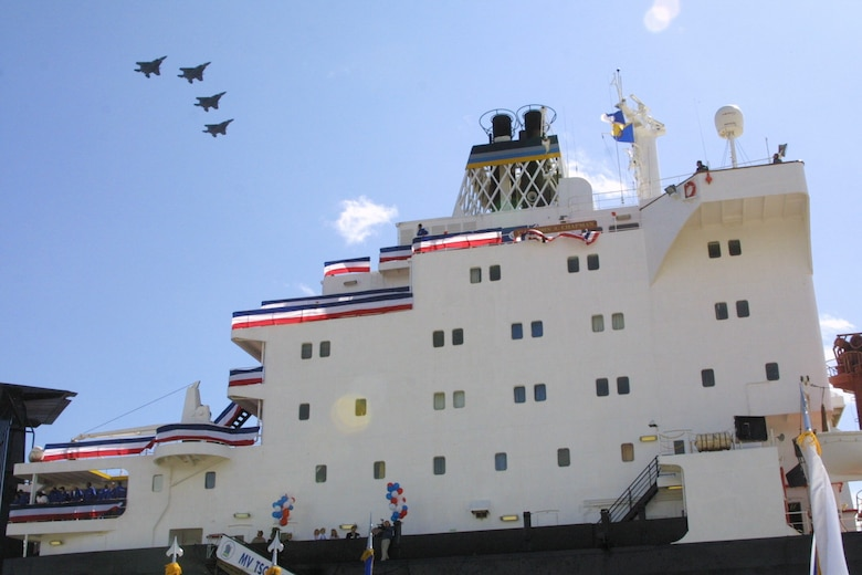SUNNY POINT, N.C. -- Four F-15 Eagles from Seymour Johnson Air Force Base, N.C., fly over the newly christened MV Tech. Sgt. John A. Chapman here April 8.  The ship was renamed for Sergeant Chapman, an Air Force combat controller who gave his life for his team in Afghanistan. (U.S. Air Force photo by Senior Airman Becky J. LaRaia)