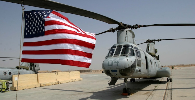 Marine Medium Helicopter Squadron 165 (REIN), 15th Marine Expeditionary Unit (Special Operations Capable), showed their patriotism by hanging flags from their helicopter blades just before flying out of Iraq. The 15th MEU (SOC) is wrapping up one month of security and stabilization operations in the Greater Baghdad area.