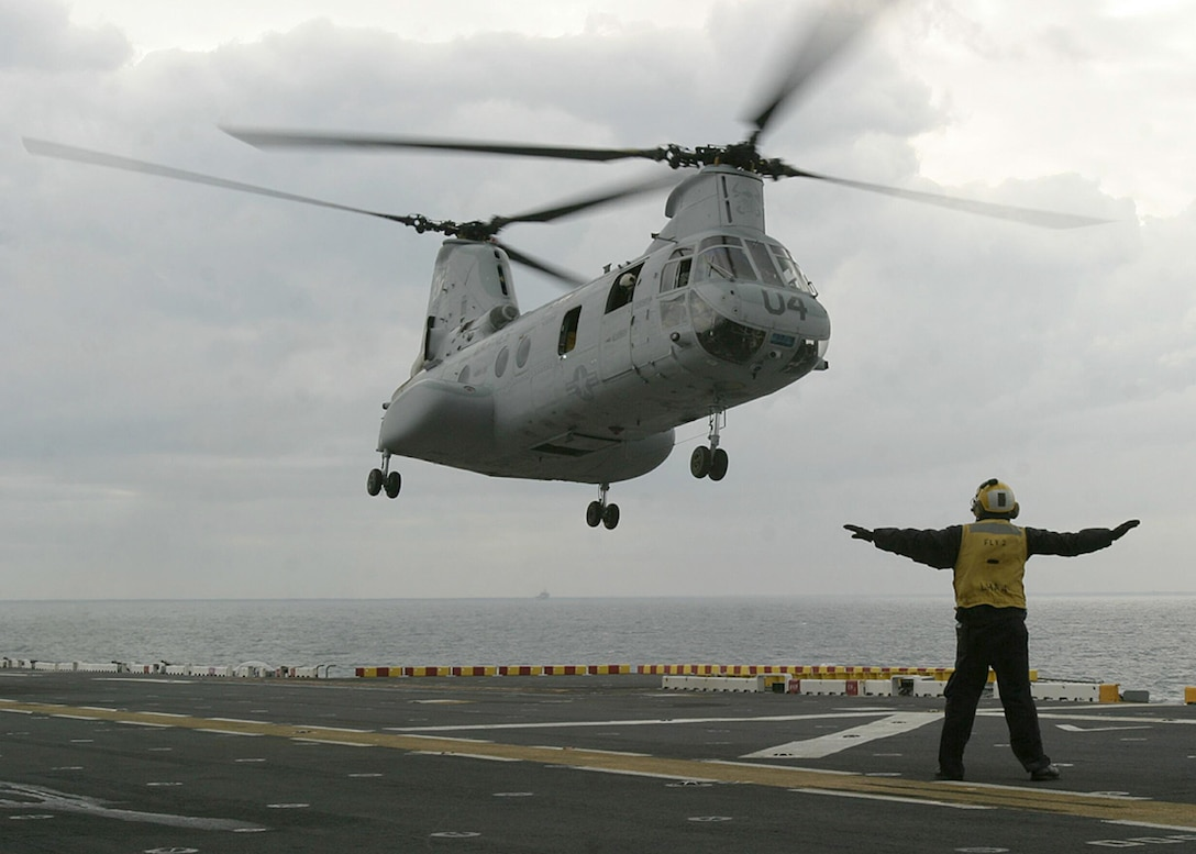 A CH-46E Sea Knight helicopter from Marine Medium Helicopter Squadron lands on the flight deck of the USS Nassau during the 22nd Marine Expeditionary Unit's recent Amphibious Specialty Training exercise off the coast of North Carolina, April 12, 2005.