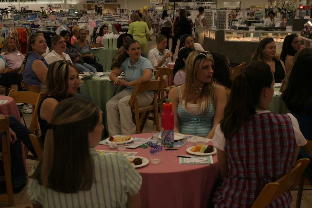 Mothers-to-be enjoy the refreshments and listen to the guest speakers at the Mothers-to-be Hi Tea at the Combat Center?s Marine Corps Exchange April 15. Several mothers-to-be won prizes from the games and drawings throughout the course of the event.