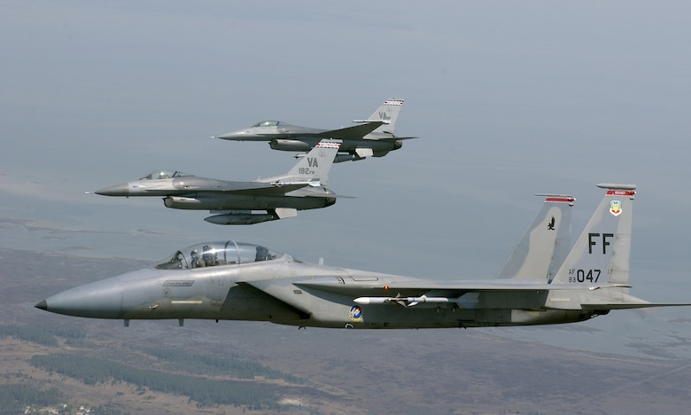 OVER VIRGINIA -- An F-15 Eagle is joined in formation by  F-16 Fighting Falcons during a training sortie here April 19. The F-15 is assigned to the 71st Fighter Squadron at Langley Air Force Base, Va., and the F-16s are assigned to the Virginia Air National Guard's 192nd Fighter Wing in Richmond.   (U.S. Air Force photo by Tech. Sgt. Ben Bloker)