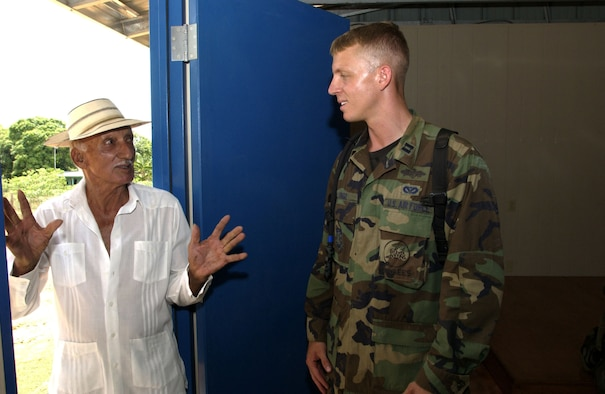 LLANO DE PIEDRA, Panama -- Capt. Star Longo talks with Bolivar Barria inside the community center the Seabees constructed here.  Captain Longo is the commander of the U.S. Naval Mobile Construction Battalion 40 (Seabees) attached to Joint Task Force Armadillo.  Task Force Armadillo is part of New Horizions 2005, a U.S. Southern Command sponsored annual training and humanitarian exercise.  Captain Longo is on a two-year exchange program with the Seabees.  (U.S. Air Force photo by Master Sgt. Lono Kollars)