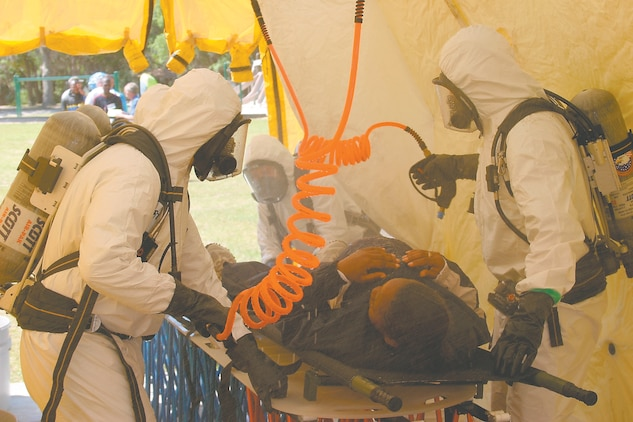 Cpl. Micah Snead Marines from Aircraft Rescue and Fire Fightinng respond to a simulated hazardous gas leak during the Anti-Terrorism Force Protection exercise held at Shady Point, April 28.