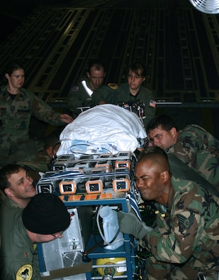 SAN ANTONIO -- A medical team from Wilford Hall Medical Center at nearby Lackland Air Force Base moves 10-month-old Carle David and a 900-pound portable heart-lung bypass machine onto an ambulance at San Antonio International Airport on April 28.  Carle is diagnosed with a severe case of pneumonia and was medically evacuated from Anchorage, Alaska.  Her chance of recovering rose from 10 percent to 90 percent.  (U.S. Air Force photo by 1st Lt. Benjamin Silva)
