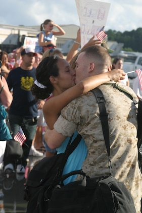 Cpl. Anthony Guas Sergeant Chad Greene, a quality assurance inspector for Marine All-Weather Fighter Attack Squadron 224, kisses his wife Briana during the Bengals homecoming Aug. 7.