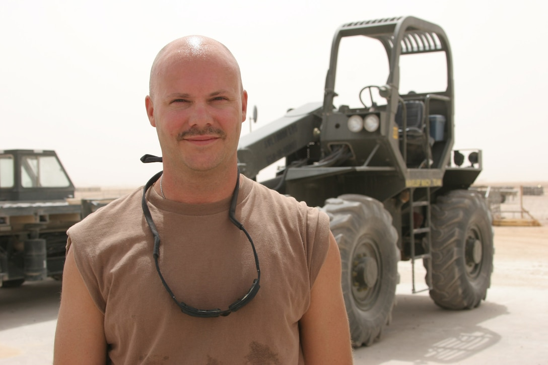 AL ASAD, Iraq ? Petty Officer 2nd Class Andy Roberts, an administrator and load planner with Mobile Air Cargo Handling Team 3 and Willard, Mo., native, is serving for the first time in Iraq in his 17-year Navy reserves? career.
