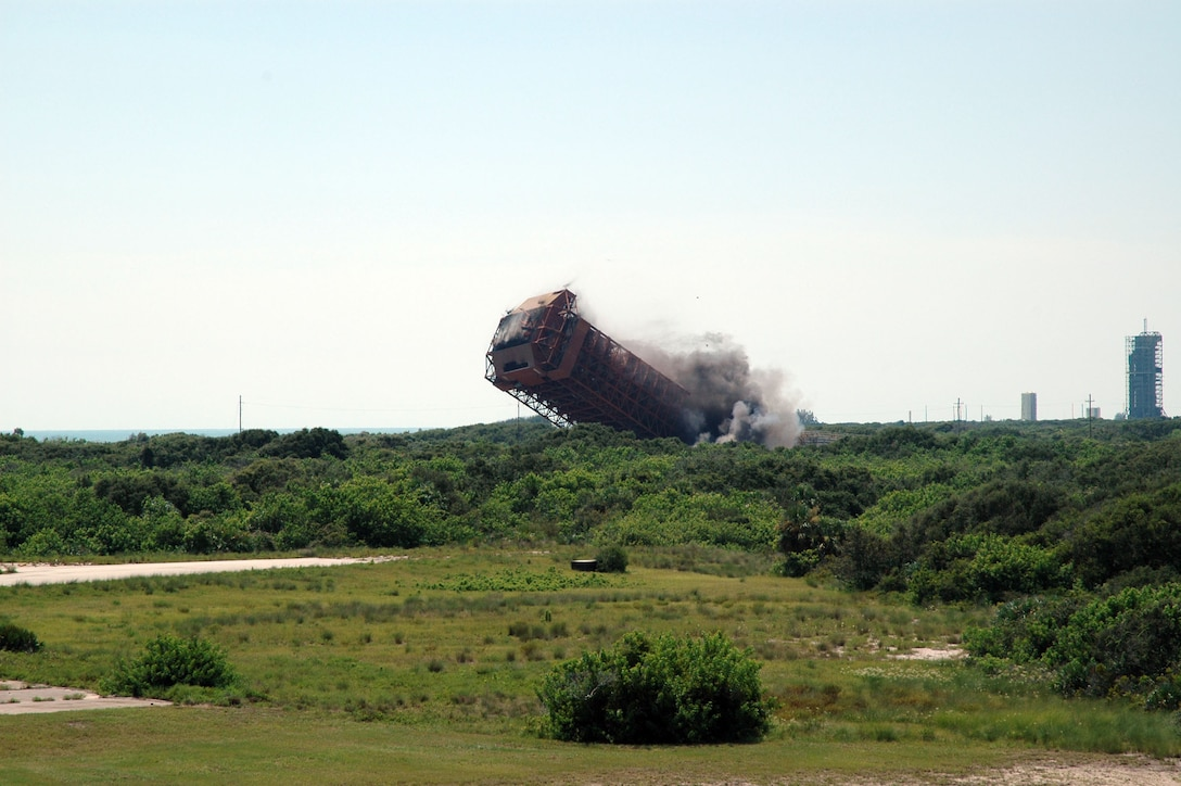 CAPE CANAVERAL AIR FORCE STATION, Fla. -- A 1,300-ton structure here is demolished Aug. 6.  The 179-foot mobile service tower was used to launch 51 Atlas/Agena space launch vehicles in the 1960s and 1970s.  (U.S. Air Force photo)