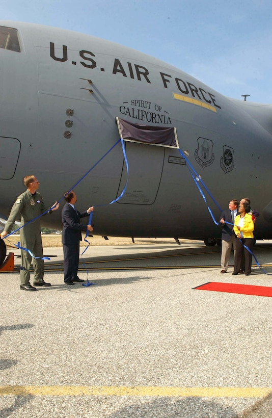 """MARCH AIR RESERVE BASE, Calif. -- (From left) Brig. Gen. James Rubeor, Ron Marcott, Rep. Ken Calvert, Maj. Gen. Robert E. Duignan and Rep. Juanita Millender-McDonald unveil the """"Spirit of California."""" Air Force Reserve Command's first C-17 Globemaster III arrived here Aug. 9. General Rubeor is the 452nd Air Mobility Wing commander, Mr. Marcott is the Boeing airlift and tanker vice president, and General Duignan is the 4th Air Force commander. (U.S. Air Force photo by Tech. Sgt. Thomas P. Dougherty)"""