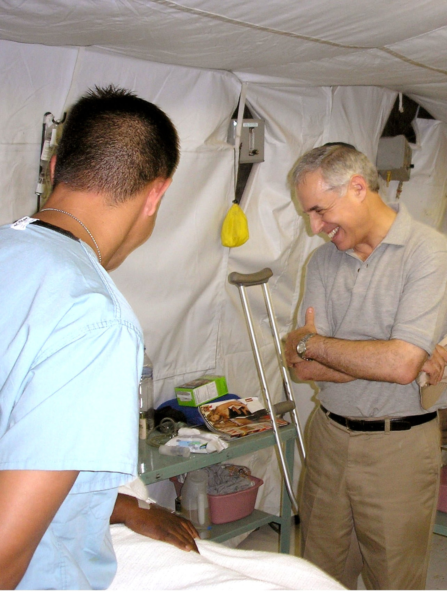 BALAD AIR BASE, Iraq -- Rabbi Arnold E. Resnicoff shares a light moment with a patient during his visit here at the Air Force Theater Hospital. (U.S. Air Force photo)