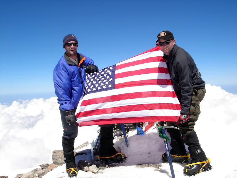 MOUNT ELBRUS, Russia -- First Lt. Mark Uberuaga (left) and Capt. Rob Marshall proudly display the American flag after reaching the summit of Mount Elbrus.  Lieutenant Uberuaga is assigned to the 21st Special Operations Squadron, and Captain Marshall is assigned to the 67th Special Operations Squadron.  Both are from Royal Air Force Mildenhall, England.  (U.S. Air Force photo)