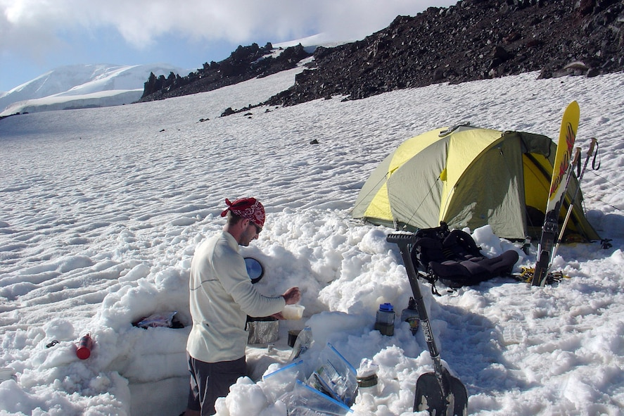 MOUNT ELBRUS, Russia -- First Lt. Mark Uberuaga prepares dinner at his base camp at 12,000 feet on Mount Elbrus.  He and Capt. Rob Marshall reached the summit in four days.  Lieutenant Uberuaga is assigned to the 21st Special Operations Squadron at Royal Air Force Mildenhall, England.  (U.S. Air Force photo by Capt. Rob Marshall)