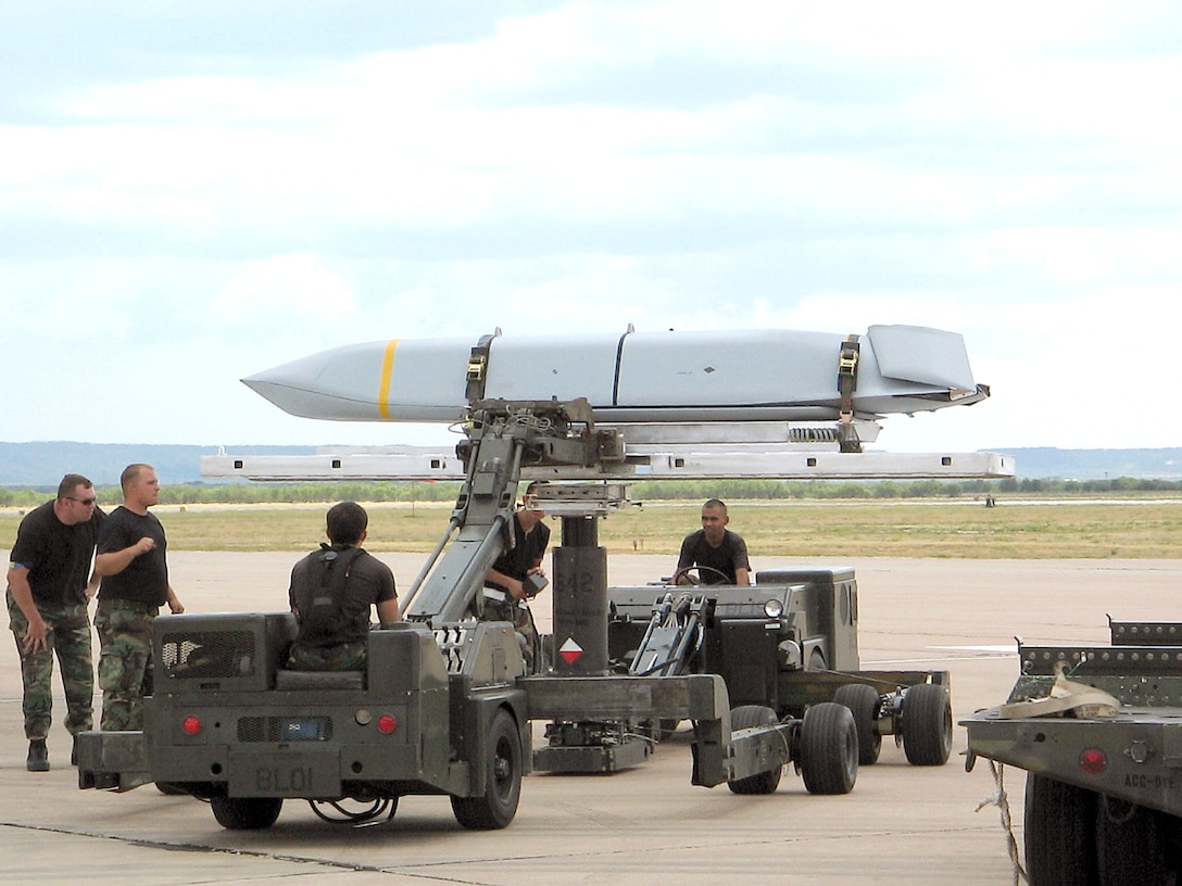 DYESS AIR FORCE BASE, Texas -- Airmen here prepare a Joint Air-to-Surface Standoff Missile to be loaded onto a B-1B Lancer. The 7th Bomb Wing here became the first unit to achieve initial operational capability of the JASSM cruise missile Aug. 18, which means the missile is able to be used in combat operations. The JASSM, or AGM-158A, is an air-to-surface, single warhead self-propelled missile. (U.S. Air Force photo)