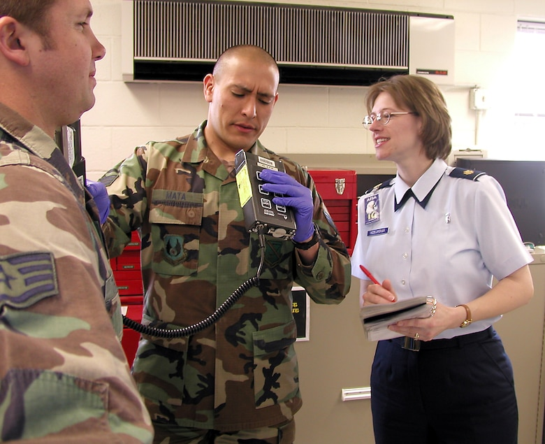 KIRTLAND AIR FORCE BASE, N.M. -- Maj. Cynthia Redelsperger ensures medics can properly monitor for radiation contamination.  She is an Air Force Inspection Agency inspector here. (U.S. Air Force photo by Capt. Gabe Johnson)