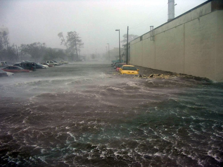 As Hurricane Katrina struck the base, rising waters swallowed cars parked along streets.  The base and the 6,000 sheltered military students, permanent party, civilians and their families survived the Category 4 hurricane with no casualties.  The initial damage was catastrophic to base infrastructure.  (U.S. Air Force file photo)