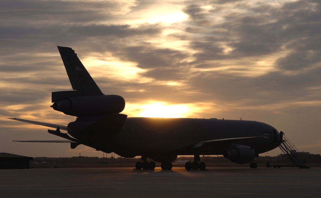 MCGUIRE AIR FORCE BASE, N.J. (AFPN) -- A KC-10A Extender aircraft parks on the flightline at sunset. The KC-10 is an advanced tanker and cargo aircraft designed to provide increased global mobility for U.S. armed forces. It can transport up to 75 people and nearly 170,000 pounds of cargo. It has three large fuel tanks that carry more than 356,000 pounds of fuel. (U.S. Air Force photo by Denise Gould)