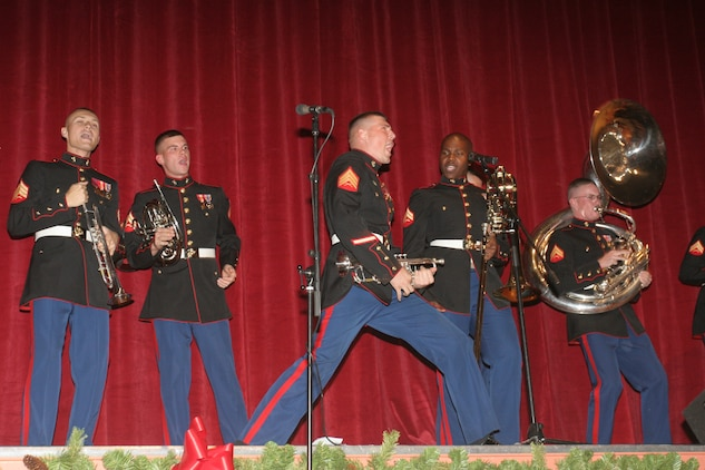 ?I want to wish you a merry Christmas,? screams Sgt. Stefan J. Spuntow while strumming his trumpet at the Commanding General?s Holiday Concert Dec. 11at Sunset Cinema.  The Party Band, a section of the Combat Center Band and directed by Staff Sgt. Joseph W. Streeter, entertains through its often-comedic songs and brash singing styles.  At this year?s holiday concert, some of the songs they performed included, ?I want a Hippopotamus for Christmas,? along with the much-loved, ?The Italian Christmas Donkey.?