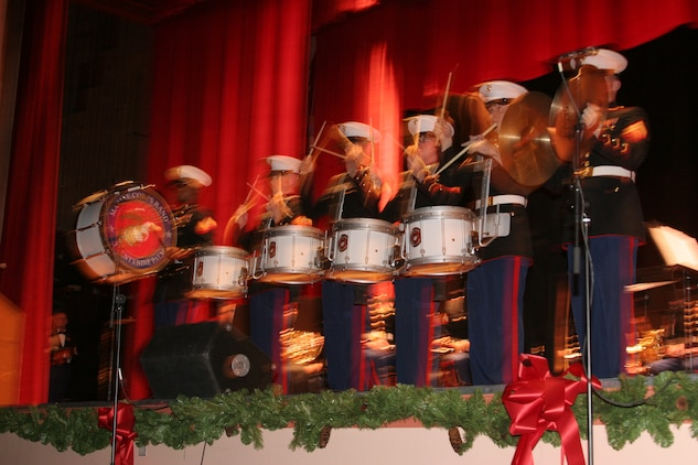 Members of the drum line from the Combat Center Band perform at the Commanding General?s Holiday Concert at Sunset Cinema Dec. 11.  Some of the songs performed at this year?s holiday concert included, ?12 Days of Christmas,? by Jerry Bilik, and ?A Christmas Festival? and ?Sleigh Ride,? by Leroy Anderson.