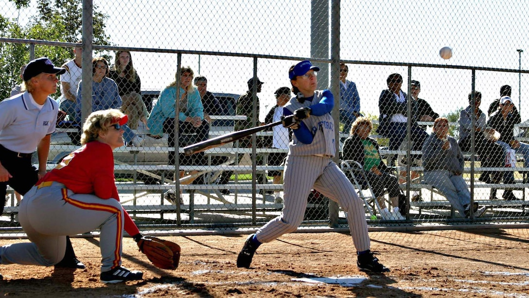 KADENA AIR BASE, Japan (AFPN) -- Staff Sgt. Twyla Sears swings at a softball during a game here. The Air Force Services Agency named Sergeant Sears the 2005 Female Athlete of the Year. The sergeant is a power production journeyman with the 353rd Operations Support Squadron. (U.S. Air Force photo)