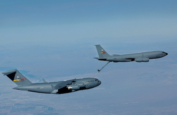 A KC-135R from the 336th Air Refueling Squadron refuels a C-17A from the 729th Airlift Squadron Dec. 6, 2005 over Arizona. Both aircraft are from the Air Force Reserve Command's 452nd Air Mobility Wing, March Air Reserve Base, Calif. (U.S. Air Force photo by Tech Sgt Rick Sforza, 4th Combat Camera Squadron)