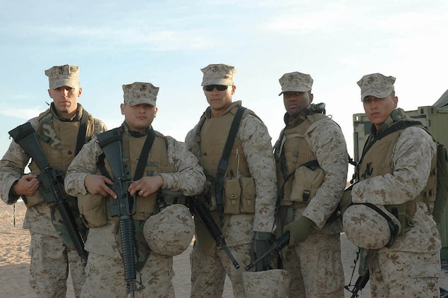 (From left to right) Sgt. Brian P. Auker, Lance Cpl. Daniel Delgado, Cpl. Richard Montgomery, Cpl. Christopher McNeal and Sgt. Brett Omara, all Marine Wing Support Squadron 274 aircraft rescue fire fighters, pose for a picture at the Cannon Air Defense Complex about five miles southeast of the air station Dec. 13. These Marines were first responders to a two-car accident while on their way to the air station Dec. 10 at the intersection of County 14th Street and Avenue 5E.