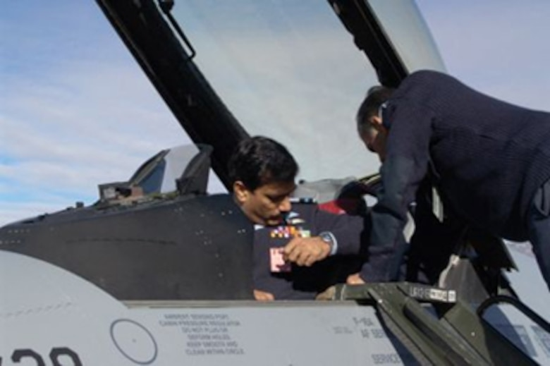 Pakistani Air Commodore (Brig. Gen.) Syed Hassan Raza, Director of F-16 Weapons System Management for F-16 Project Falcon, inspects one of the transfer aircraft at Hill AFB, Utah. (Air Force photo by Dane Anderson)