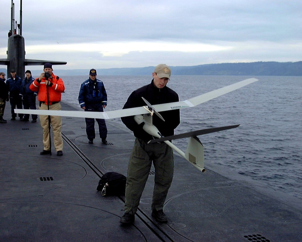 Air Force special operations forces from the 22nd and 23rd Special Tactics Squadrons prepare to launch a Pointer UAV from the deck of USS Alabama (SSBN 731) in the Pacific Ocean during a recent exercise to test special operations infiltration and rescue tactics. The joint effort also tests the capabilities of the SSGN class submarines entering service next year. The SSGN class submarines are being converted from ballistic missile submarines to guided missile submarines with new capabilities.  US Navy photo by FTCM (SS) Daniel J. Niclas