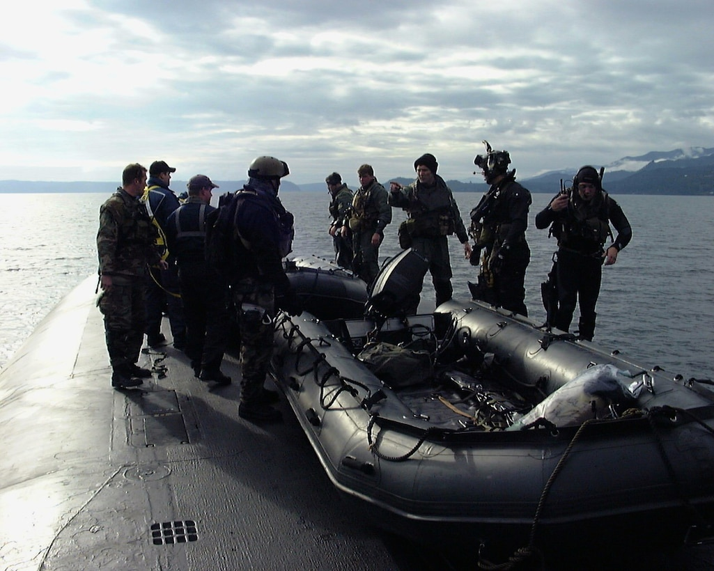 Air Force special operations forces from the 22nd and 23rd Special Tactics Squadrons prepare to launch an inflatable boat from the deck of USS Alabama (SSBN 731) in the Pacific Ocean during a recent exercise to test special operations infiltration and rescue tactics. The joint effort also tests the capabilities of the SSGN class submarines entering service next year. The SSGN class submarines are being converted from ballistic missile submarines to guided missile submarines with new capabilities.  US Navy photo by FTCM (SS) Daniel J. Niclas
