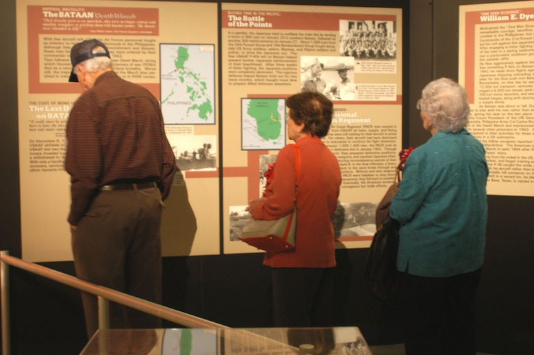 DAYTON, Ohio -- Members of the Defenders of Bataan and Corregidor reunion group look at the Bataan Death March exhibit at the National Museum of the United States Air Force. (U.S. Air Force photo)