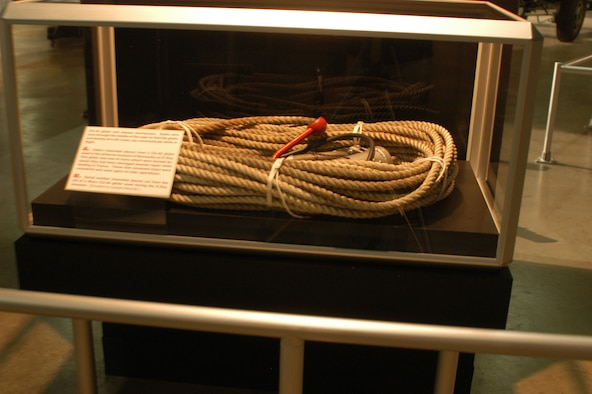 DAYTON, Ohio -- CG-4A glider and release mechanism. Radio wire runs through the middle of the rope so that the glider and towing aircraft crews can communicate while in flight. This item is on display in the World War II Gallery at the National Museum of the U.S. Air Force. (U.S. Air Force photo)