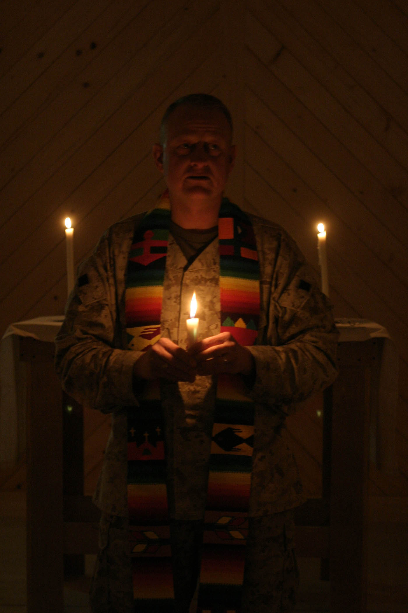 Service members celebrate on Christmas Eve with candle light vigil ...