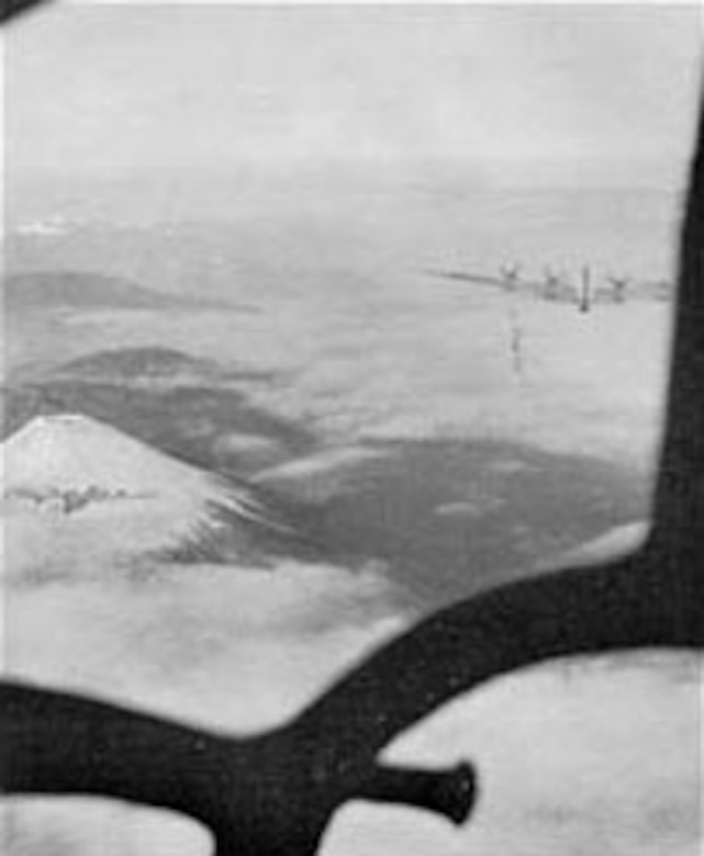 Mt. Fuji as seen through the nose of a B-29 over Japan on the first mission against Tokyo since the visit of General Doolittle's medium bombers in April 1942. Bombs were released over the primary target, the Musashino aircraft plant, on Nov. 24, 1944. (U.S. Air Force photo)