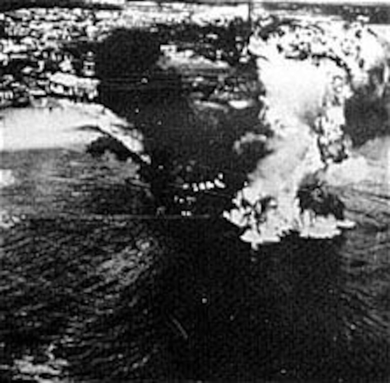 B-25s leave a Japanese tanker aflame at Mako Island in the Formosa Strait in April 1945. (U.S. Air Force photo)