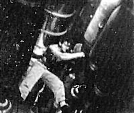 A B-29 armorer at Guam places a fuze in a 500-pound bomb. (U.S. Air Force photo)