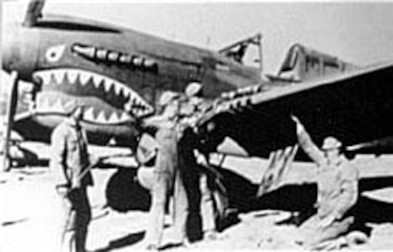 Chinese soldiers and AAF armorers clean the guns on a 23rd Fighter Group P-40 in Kunming, China, February 1943. (U.S. Air Force photo)