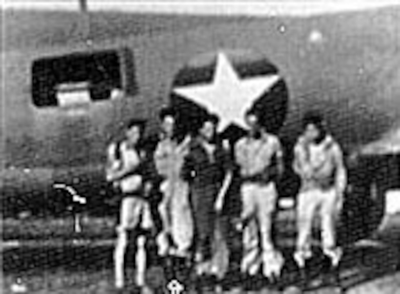 Crewmembers of a 25th Bomb Squadron B-17 following an armed reconnaissance flight over New Britain Island, during which they shot down three enemy fighters. (U.S. Air Force photo)