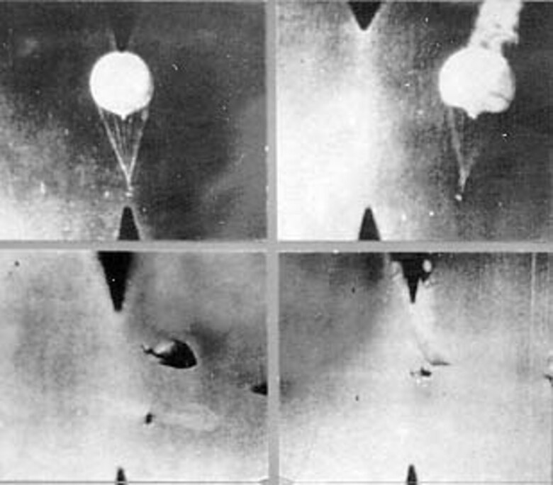 This gun camera photograph shows balloons being shot down by 11th Air Force fighters near Attu in the Aleutians on April 11, 1945. Nine balloons were downed in two hours. Note the P-38 in lower right frame. (U.S. Air Force photo)