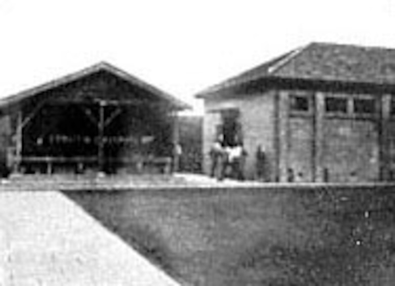 Compound at Kiangwan Military Prison, Shanghai, where the surviving men were kept for nearly 40 months. Washing facilities are at left, cell block at right, yard in foreground is where they were permitted 30 minutes daily exercise. (U.S. Air Force photo taken by an American officer who was gathering evidence for the War Crimes Trial after Japanese surrender)