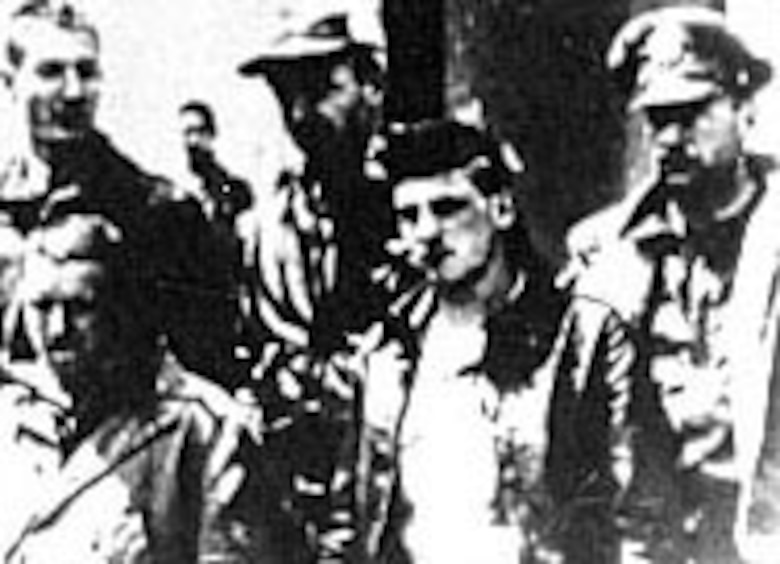 The crew of Lt. Farrow's plane after being captured. In front are Cpl. Jacob DeShazer (left) and Sgt. Harold A. Spatz; in rear, left to right, are Lt. William G. Farrow, Lt. Robert L. Hite and Lt. George Barr. Farrow and Spatz were two of those executed on Oct. 15, 1942. (U.S. Air Force photo)