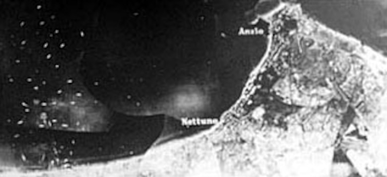 Composite photograph of the Allied landing on the Italian coast at Anzio. The lower left portion was taken while the beach was under attack by German airplanes. (U.S. Air Force photo)