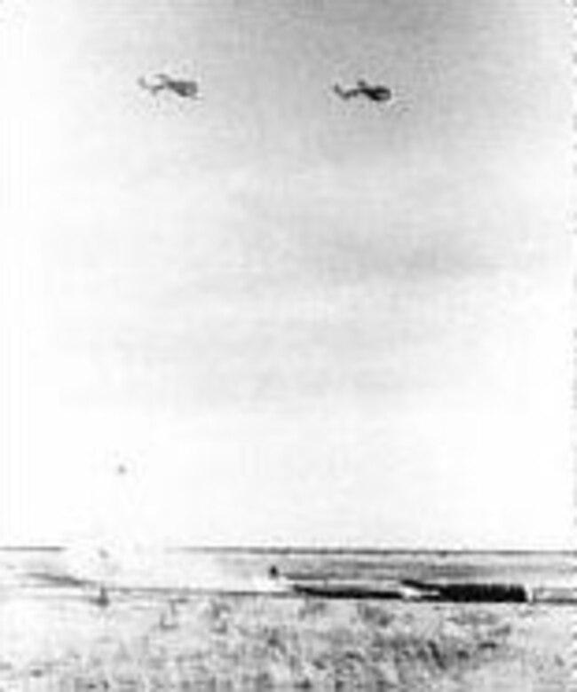 AT-11s drop practice bombs. (U.S. Air Force photo)