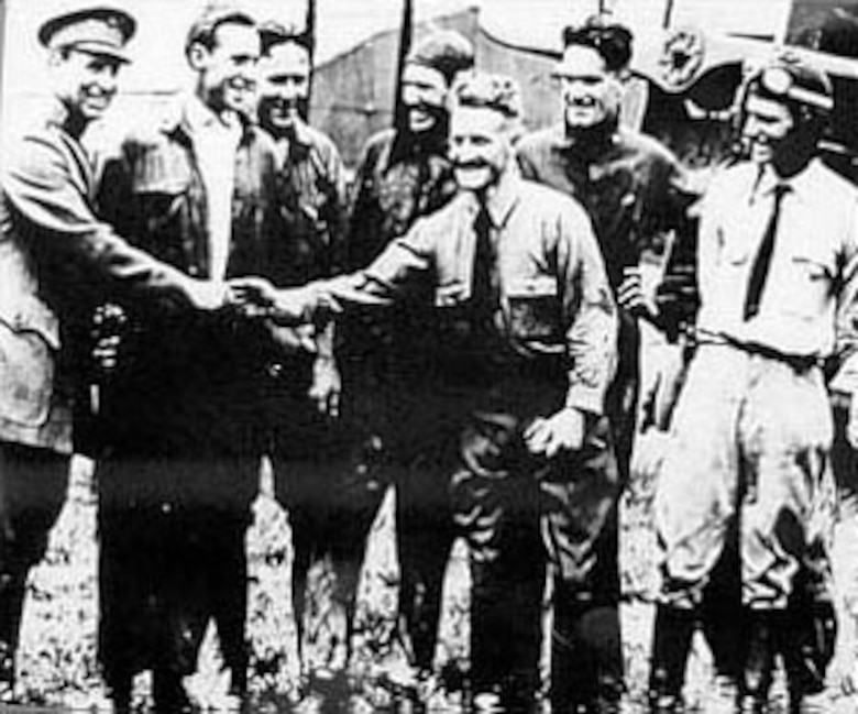 Gen. Billy Mitchell congratulates Capt. St. Clair Streett upon the return of the first Alaskan flight to the United States. (U.S. Air Force photo)