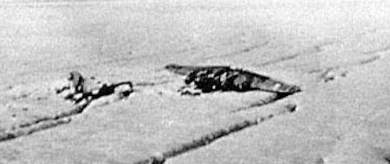 "When ""My Gal Sal"" was rediscovered in 1964, the plane was relatively undamaged. By the time the recovery team reached the site a year later, the plane appeared as in it is here. A strong winter wind had blown the forward part onto its back, severely damaging it. (U.S. Air Force photo)"