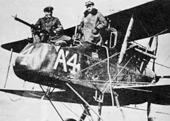 British two-seater pusher with swivel machine gun in front for use by the observer. This airplane was shot down and captured by the Germans. The victorious German pilot, Lt. Heinrich Dontermann, is standing in the rear cockpit. (U.S. Air Force photo)