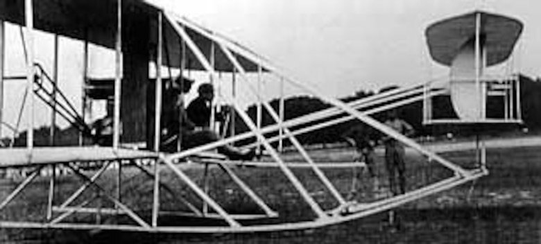 Lt. Frank Lahm and Orville Wright ready for takeoff on the first official flight of the 1909 flyer. (U.S. Air Force photo)