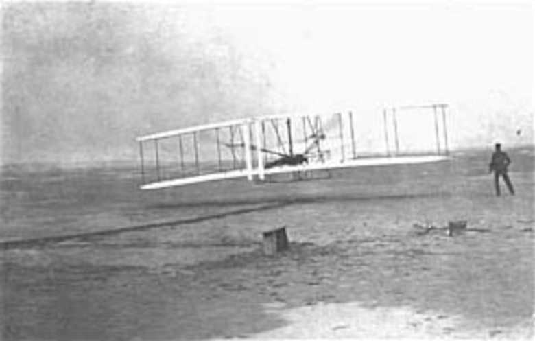 Take-off of the 1903 Wright flyer on the world's first powered, sustained and controlled heavier-than-air flight, Dec. 17, 1903, at Kitty Hawk, N.C. (U.S. Air Force photo)