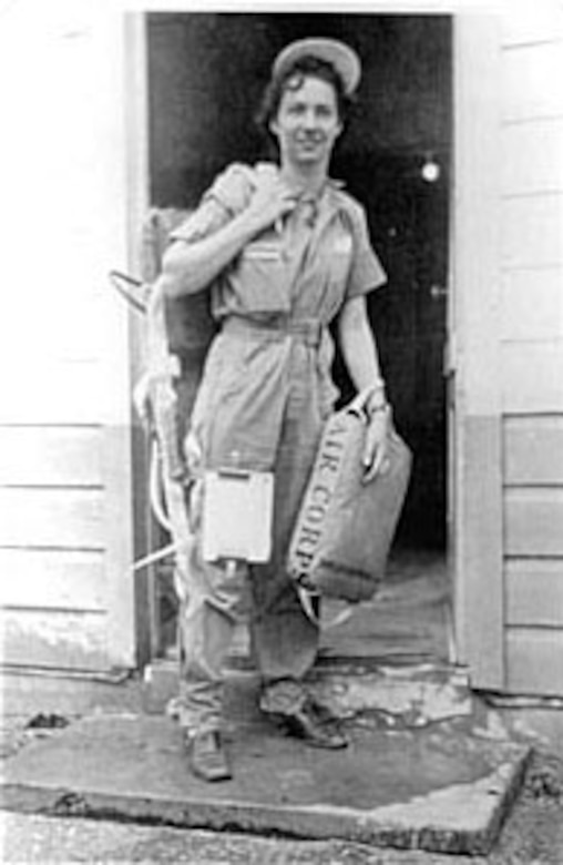 WASP Nadine Canfield (Nagle) wears flight coveralls and carries a parachute and seat cushion. (U.S. Air Force photo)