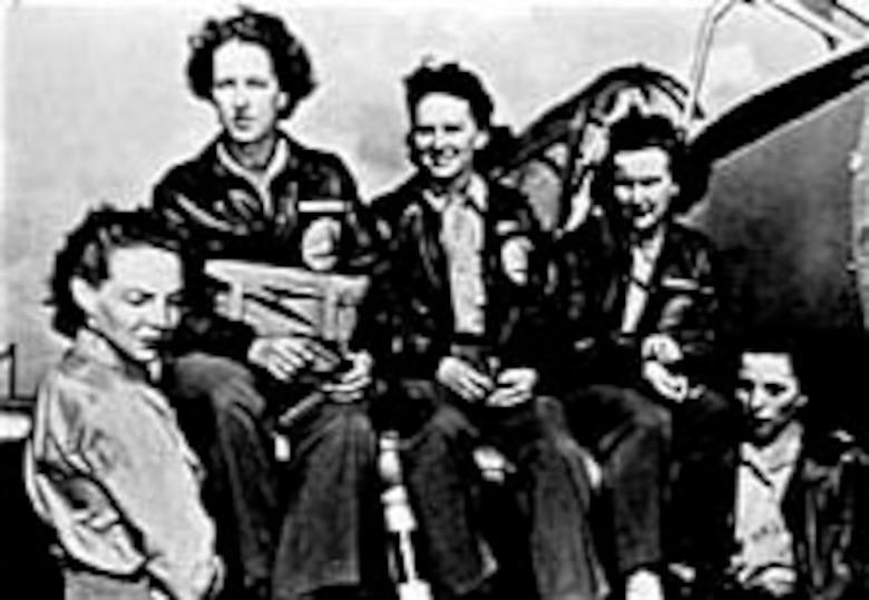 Evelyn Sharp (middle) was a barnstormer with more than 3,000 flying hours. (U.S. Air Force photo)