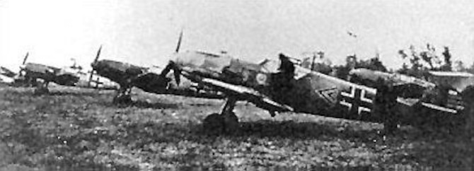Me 109s of JG/2 (the Richthofen Squadron) at a Luftwaffe airfield in Western Europe in the summer of 1940. The plane in the foreground was assigned to Oberleutnant Helmut Wick, a Luftwaffe ace with 56 victories at the time he was shot down on Nov. 28, 1940. Wick had 32 victory bars on the rudder of his plane at the time this photo was taken. (U.S. Air Force photo)