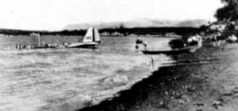 """In the only accident during the B-10 flight to Alaska, engine trouble forced one plane to land in the water of Cook's Inlet at Anchorage. The plane was pulled from the water and """"dried out"""" before completing the return flight to Washington, D.C. (U.S. Air Force photo)"""