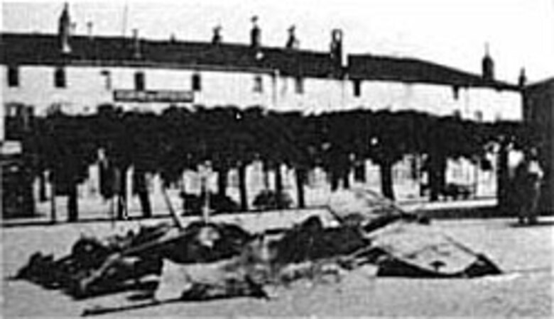 "Remains of the Pfalz D.III shot down in flames by Lt. Campbell one minute after Lt. Winslow had scored his victory. The French hauled the burnt remains to the square in Toul for display. On May 31, 1918, Lt. Campbell became the first U.S.-trained pilot to receive official credit for his fifth victory, thus becoming an ""ace."" (U.S. Air Force photo)"
